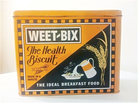 A-commemorative-Weetbix-box-in-orange-tin-vintage-and-antique-collectibles-available-in-Canberra-at-the-Lost-and-Found-Office