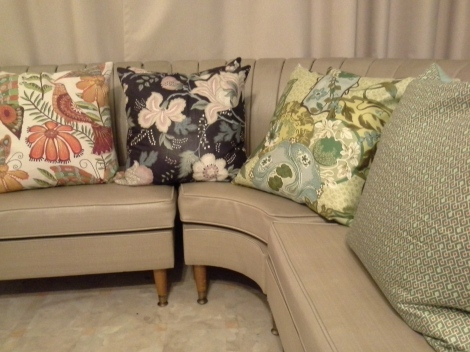 designer vintage fabrics and high quality feather cushions former our summer range.